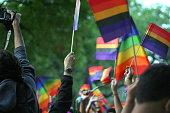 Pride Paraders Waving Flags