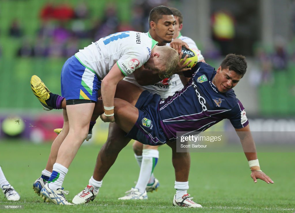Pride Petterson-Robati of the Storm is tackled during the round eight Holden Cup match between the Melbourne Storm and the Canberra Raiders at AAMI Park on May 4, 2013 in Melbourne, Australia.