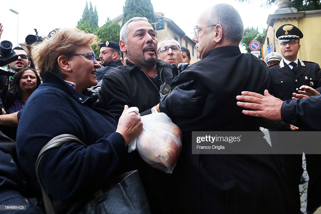 A priest arrives at the church of Lefebvriani to attend at the funeral ofl Erich Priebke on October 15, 2013 in Albano Laziale, Italy. The funeral of Erich Priebke, a former SS officer convicted of participating in the massacre of 335 citizens in Italy during World War II will now take place at the Lefebvriani Chapel in Albano Laziale, after the Catholic Church announced in a statement soon after his death that 'no public funeral would be granted to him in the city or outskirts of Rome'. His burial is not yet settled after his German hometown refused to allow his burial there.