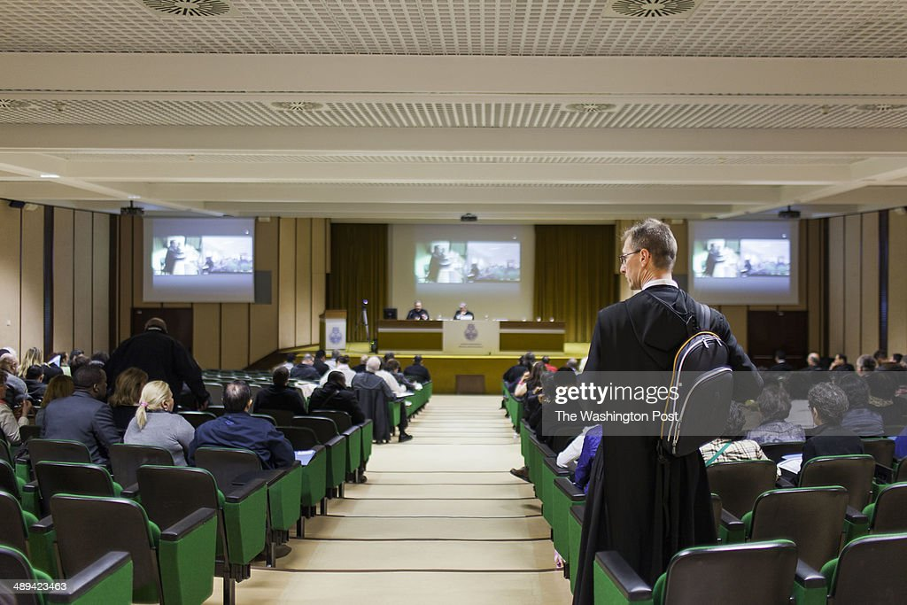 A priest arrives to attend the Exorcism and Prayer of Liberation annual conference at the Pontifical Athenaeum Regina Apostolorum on May 5 2014 in...