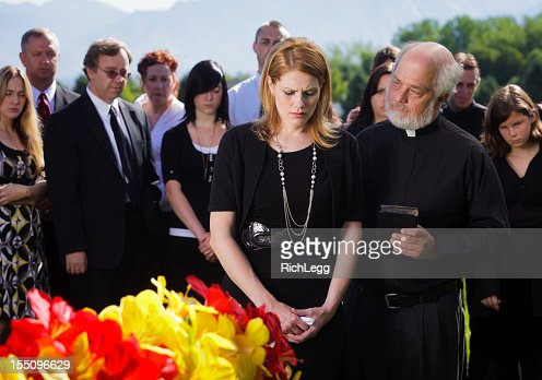 Priest at a Funeral