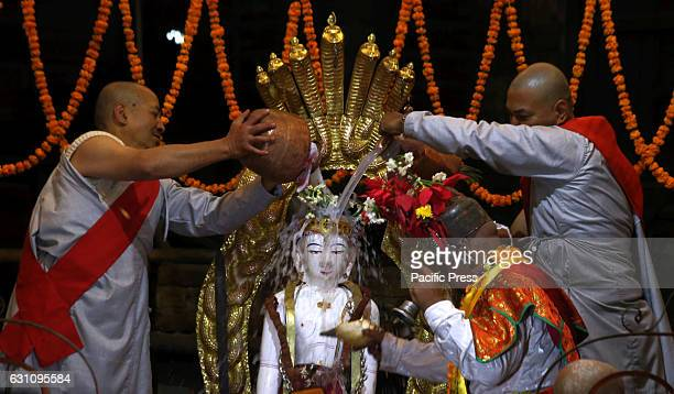 MACHHENDRABAHAL KATHMANDU NEPAL Priest bath the idol of Seto Machhendranth during annual bathing procession as worshipping the Lord Machhendranath in...