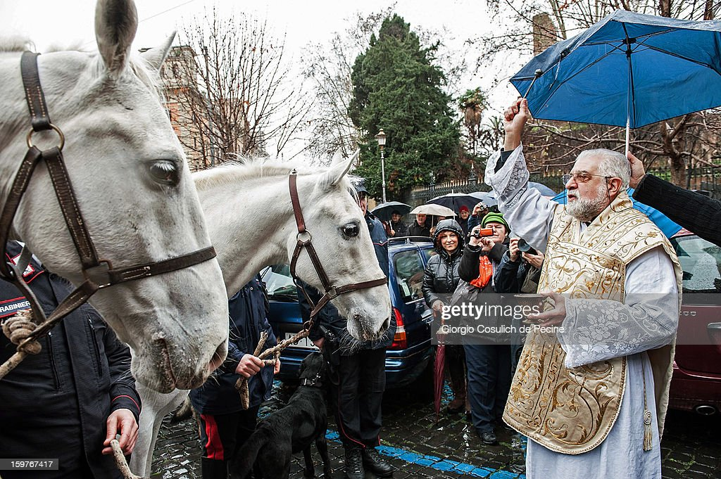 A priest blesses two horses after a traditional mass for the blessing of animals at the Sant'Eusebio church on January 20, 2013 in Rome, Italy. Every year during the feast of St. Anthony the Abbot animals are blessed in countries around the world.