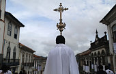 A priest carries a cross in the annual Easter procession during traditional Semana Santa festivities on April 5 2015 in Ouro Preto Brazil Holy Week...