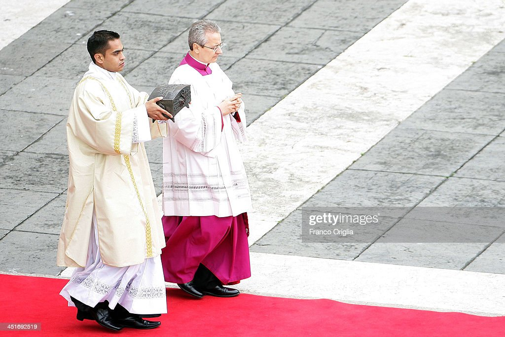 A priest carries relics of St. Peter the apostle, (fragments of bone) for the veneration of believers (for the first time in nearly 2,000 years), during the end of the Solemnity of Christ the King in St. Peter's square on November 24, 2013 in Vatican City, Vatican. Today's solemnity of Our Lord Jesus Christ, King of the Universe, the crowning of the liturgical year, marks the conclusion of the Year of Faith proclaimed earlier by Pope emeritus Benedict XVI in the last year of his reign.