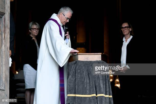 Priest Christophe Le Sourt blesses the coffin of French judge JeanMichel Lambert during his funeral at the SaintJulien Cathedral in Le Mans...