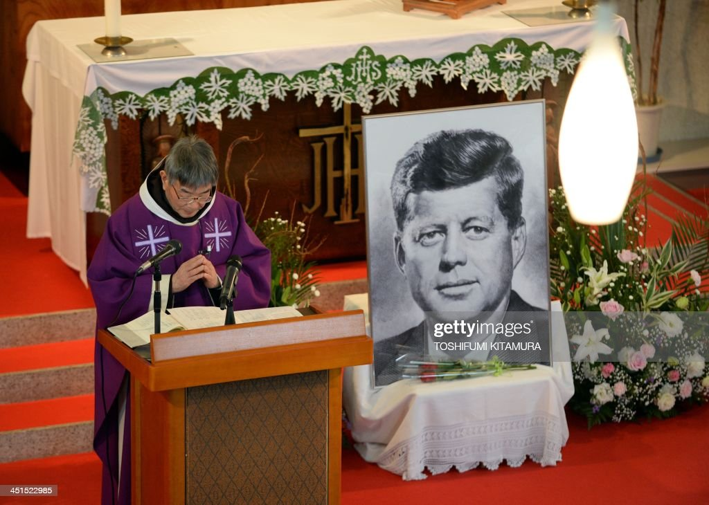 Priest Eiji Tanaka (L) leads a mass in honour of former US president John F. Kennedy on the 50th anniversary of his assassination at his San-no Cho Catholic Toyama church in Toyama on November 23, 2013. About 100 followers in different religions gathered to mourn the late US president.