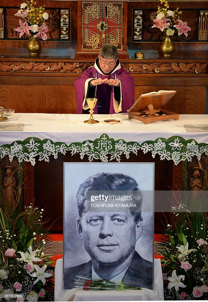 Priest Eiji Tanaka leads the mass in honour of former US president John F. Kennedy on the 50th anniversary of his assassination at his San-no Cho Catholic Toyama church in Toyama on November 23, 2013. About 100 followers in different religions gathered to mourn the late US president.