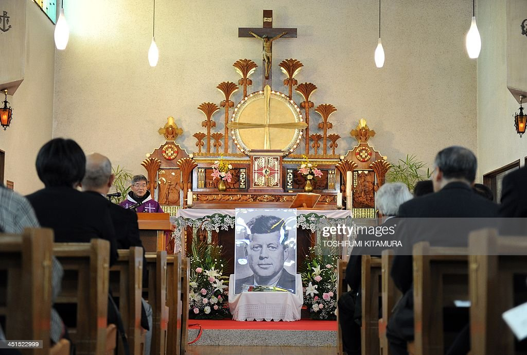 Priest Eiji Tanaka (3rd L) leads the mass in honour of former US president John F. Kennedy on the 50th anniversary of his assassination at his San-no Cho Catholic Toyama church in Toyama on November 23, 2013. About 100 followers in different religions gathered to mourn the late US president.