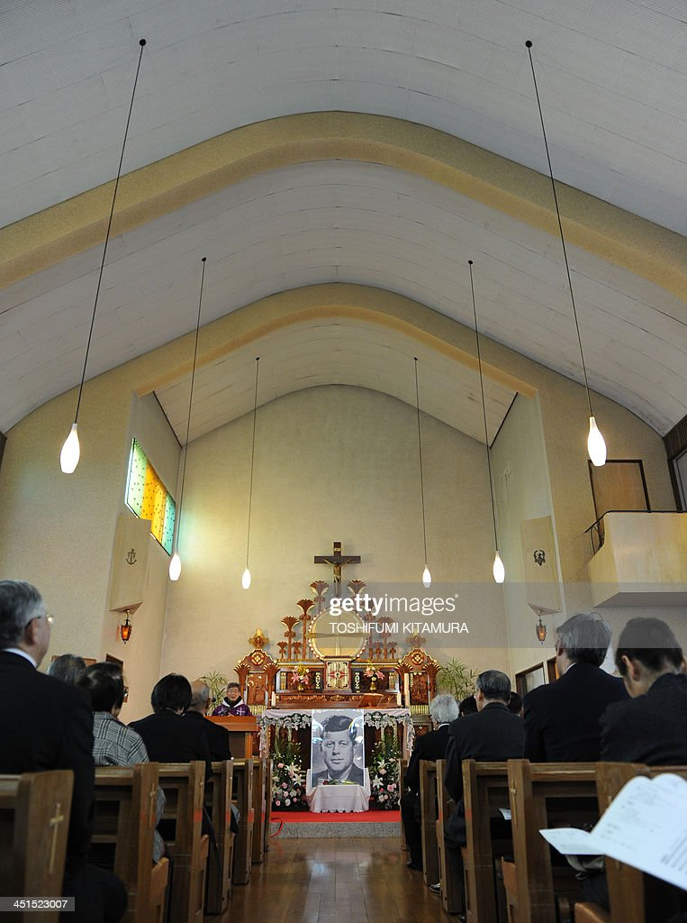 Priest Eiji Tanaka (6th L) leads the mass in honour of former US president John F. Kennedy on the 50th anniversary of his assassination at his San-no Cho Catholic Toyama church in Toyama on November 23, 2013. About 100 followers in different religions gathered to mourn the late US president. AFP PHOTO / TOSHIFUMI KITAMURA