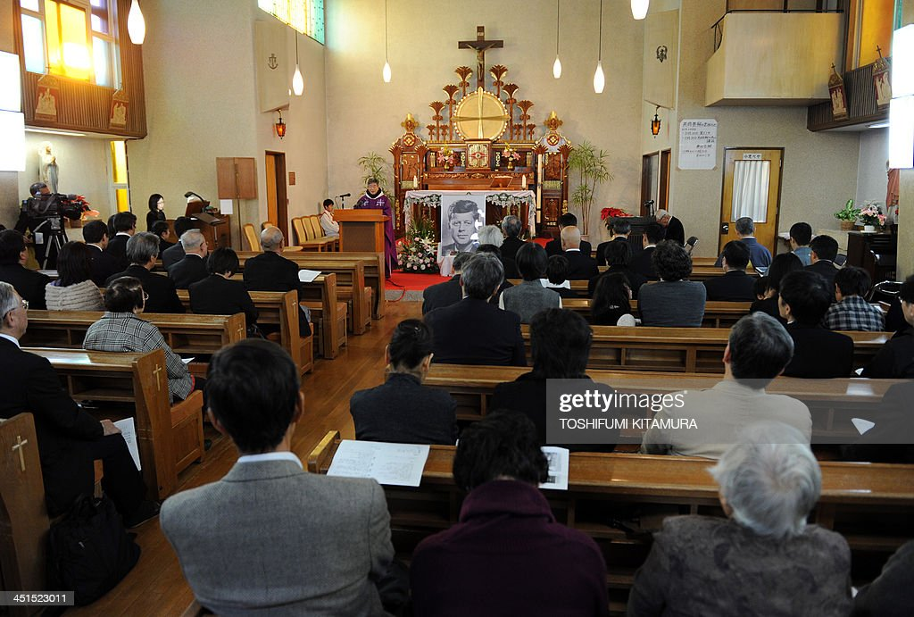Priest Eiji Tanaka (C-L) leads the mass in honour of former US president John F. Kennedy on the 50th anniversary of his assassination at his San-no Cho Catholic Toyama church in Toyama on November 23, 2013. About 100 followers in different religions gathered to mourn the late US president.