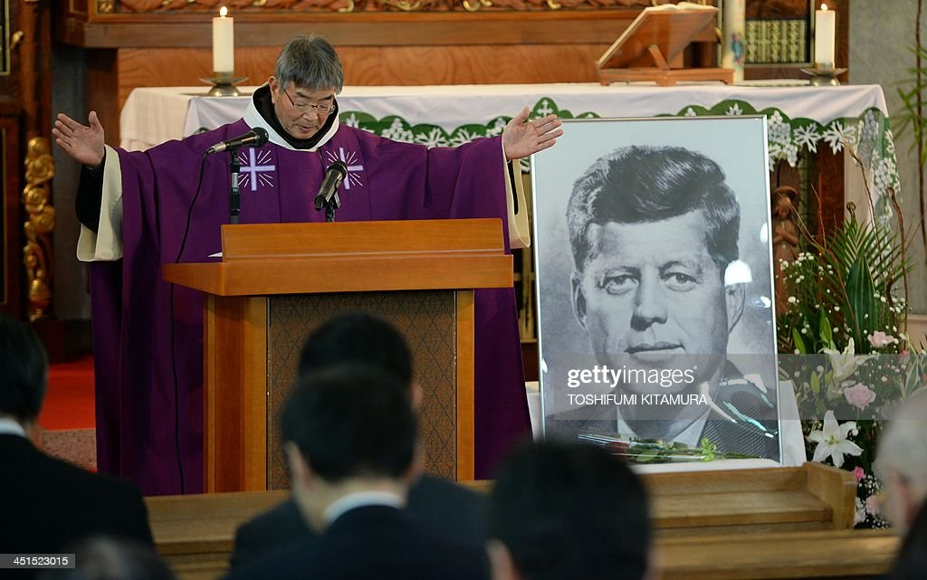 Priest Eiji Tanaka (C) leads the mass in honour of former US president John F. Kennedy on the 50th anniversary of his assassination at his San-no Cho Catholic Toyama church in Toyama on November 23, 2013. About 100 followers in different religions gathered to mourn the late US president.