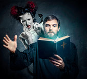 Priest evicting demons, conceptual photo