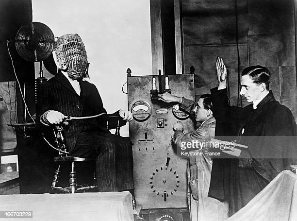 A priest giving the last blessing to a man sentenced to death on the electric chair in 1928 in the United States