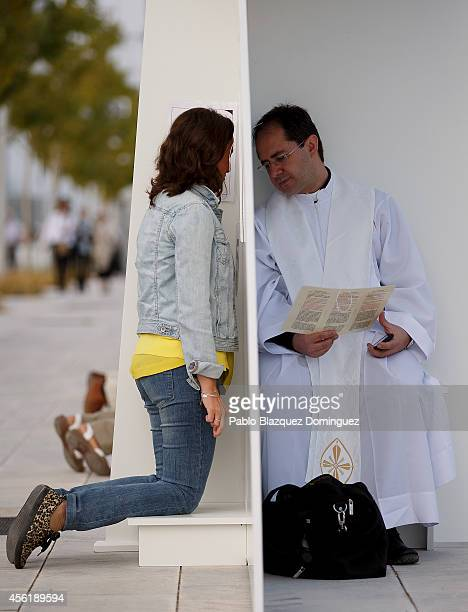 A priest hears a confession before the start of the beatification ceremony for Opus Dei former leader Alvaro del Portillo on September 27 2014 in...