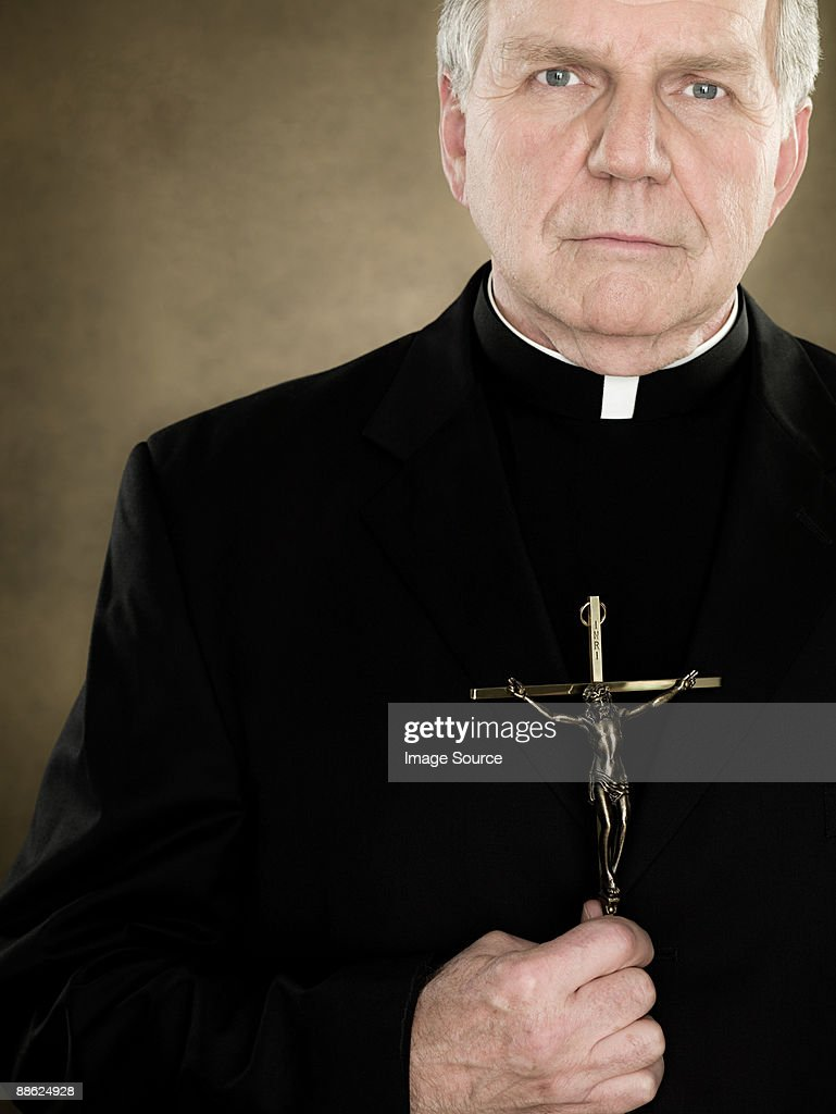A priest holding a crucifix
