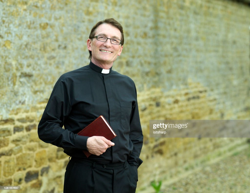 Priest holding Bible