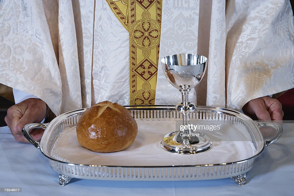 Priest holding communion tray, close-up : Stock Photo