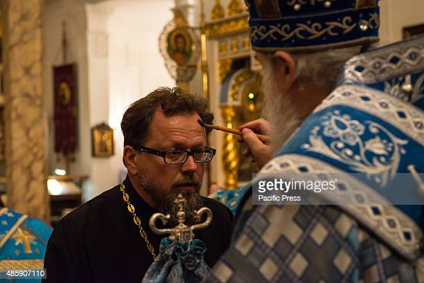 A priest is anointed with oil by visiting Bishop Gabriel of Montreal On the eve of the Feast of the Dormition of the Virgin the twelfth and final...