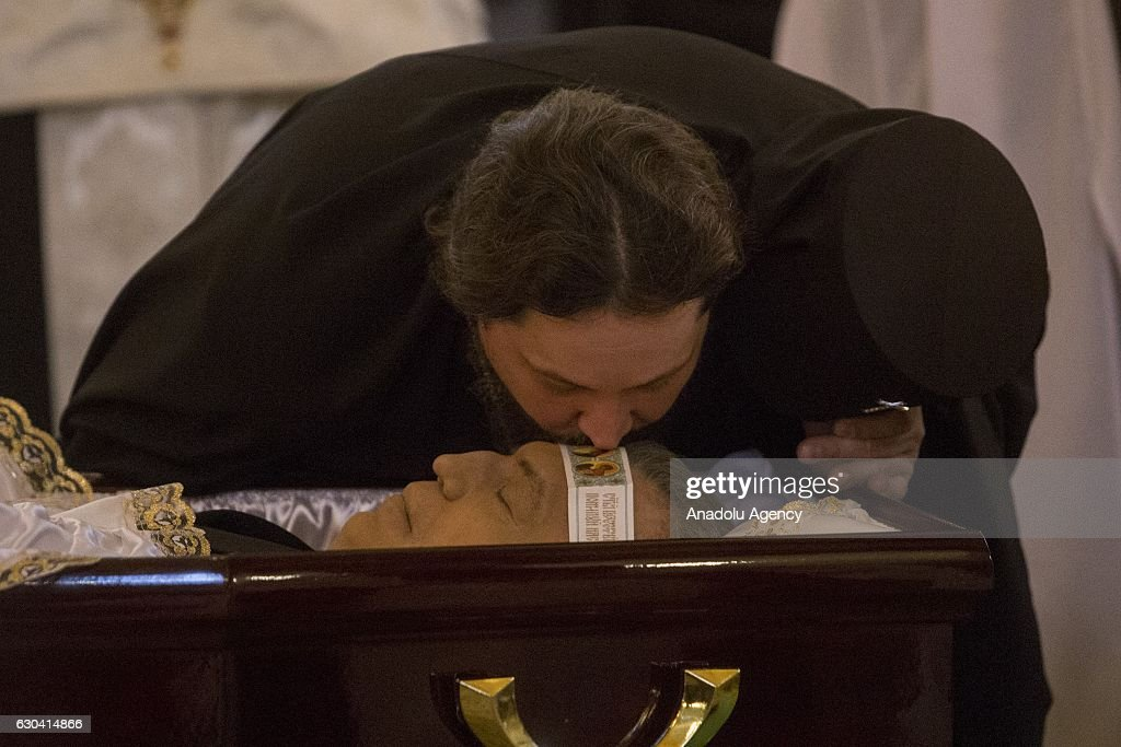 A priest kisses the face of Andrey Karlov during funeral service for Russia's ambassador to Turkey Andrey Karlov, in Christ the Savior Cathedral in Moscow, Russia, on December 22, 2016. Karlov was delivering a speech at the opening ceremony of a photo exhibit when an armed assailant 22-year-old riot police officer Mevlut Mert Altintas opened fire on him. Assailant has been killed by the Turkish police during a fire exchange at the crime scene.