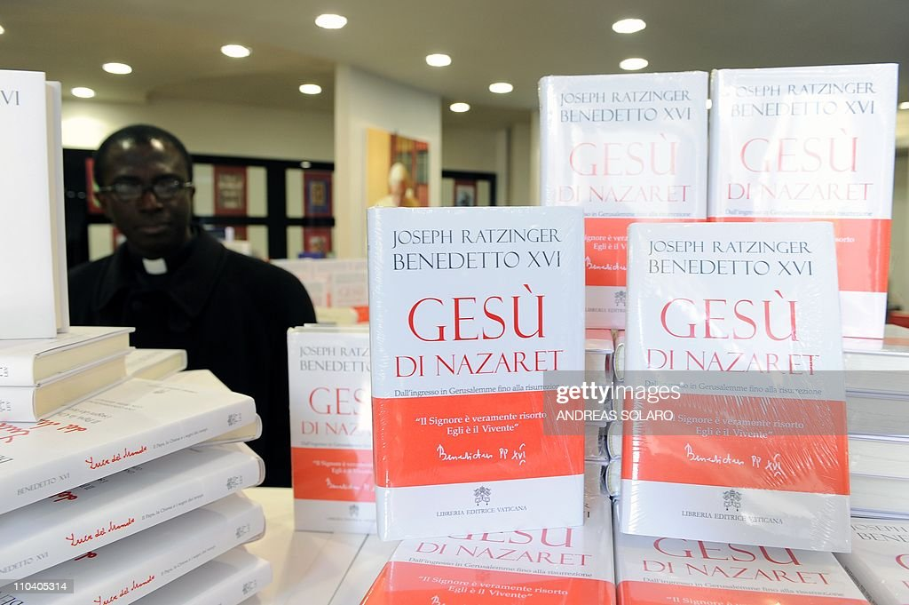 A priest looks at copies of the second volume of 'Jesus of Nazareth' Pope Benedict XVI's biography of Christ the day it is released on March 10 2011...