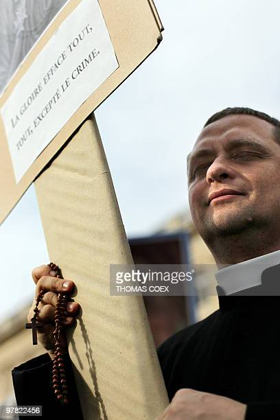 A priest marches with antiabortion demonstrators who protest on March 18 2010 in front of the Institute of France in Paris during the welcoming...