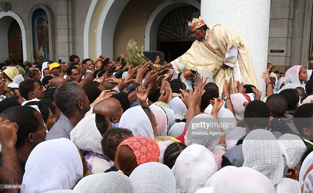 Priest Mesele Gebre conducts a blessing service as Orthodox Christians gather at the Medhane Alem Cathedral to observe Good Friday ahead of the Easter in Addis Ababa, Ethiopia on April 29, 2016. Good Friday is a Christian religious holiday commemorating the crucifixion of Jesus Christ and his death at Calvary.