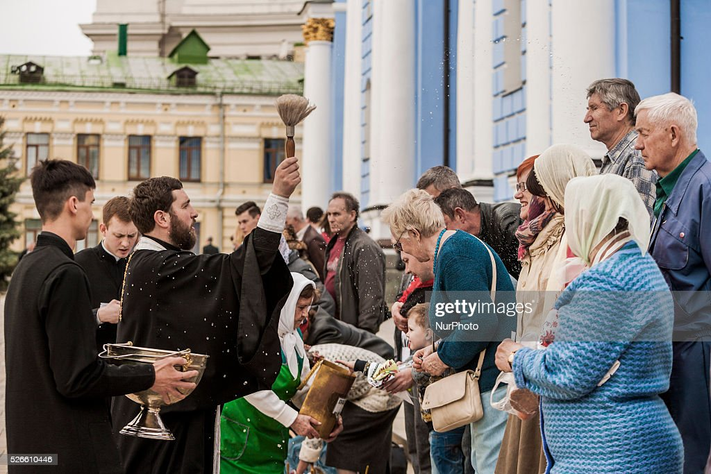 Priest of the St. Michael��s Cathedral blesses Orthodox parishioners with water in Kiev, Ukraine on 30 April 2016.