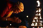 Priest offer evening prayer during Navratri Festival celebration at Sangam confluence of River Ganga Yamuna and Mythological Saraswati