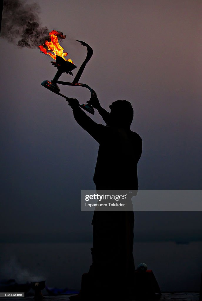 Priest performing morning rituals : Stock Photo