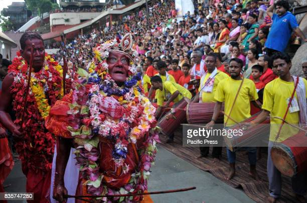 A priest performs a dance with a goat during the 3rd day of Deodhani Festival at the Kamakhya Temple in Guwahati on Saturday August 19 2017 The...