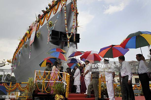 A priest performs rituals to Kavaratti an AntiSubmarine Warfare Corvette built by Garden Reach Shipbuilders and Engineers Limited Kolkata for the...