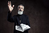 Priest holding Holy Bible