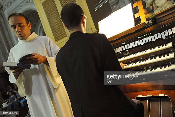 A priest prays before a showing of an ampoule containing blood of Saint Januarius in Naples cathedral on September 19 2012 Saint Januarius the Saint...