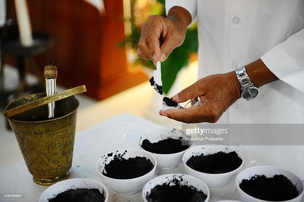 A Priest prepares black ashes for the Ash Wednesday ceremony at Roh Kudus Church on March 5, 2014 in Surabaya, Indonesia. Ash Wednesday marks the beginning of Lent, a 40-day period of pray and fasting before Easter.