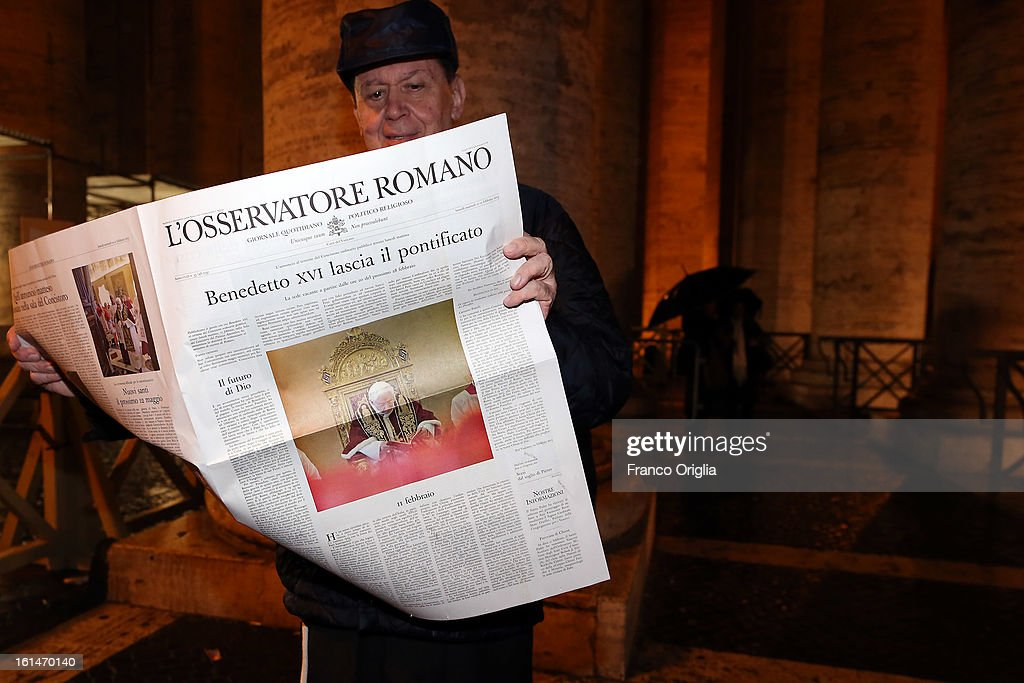 A priest reads a special edition of the 'Osservatore Romano' (Official Vatican newspaper) announcing the retirement of the Pope in St. Peter's Square on February 11, 2013 in Vatican City, Vatican. Pope Benedict XVI today announced that he is to retire on February 28 citing age related health reasons.