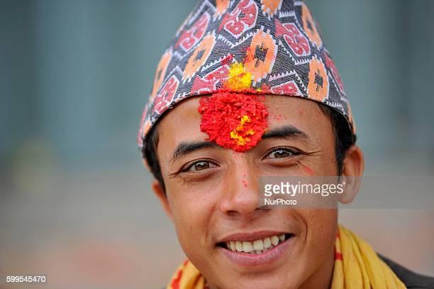 A Priest smiles as offering ritual prayer at Rishishwor Mahadev Temple during Rishi Panchami Festival celebrations at Teku Katmandu Nepal on Tuesday...