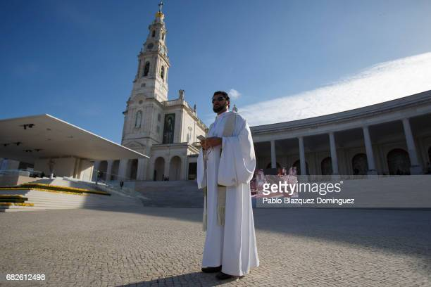 A priest stands before the start of the ceremony of canonization at the Sanctuary of Fatima on May 13 2017 in Fatima Portugal Pope Francis is...