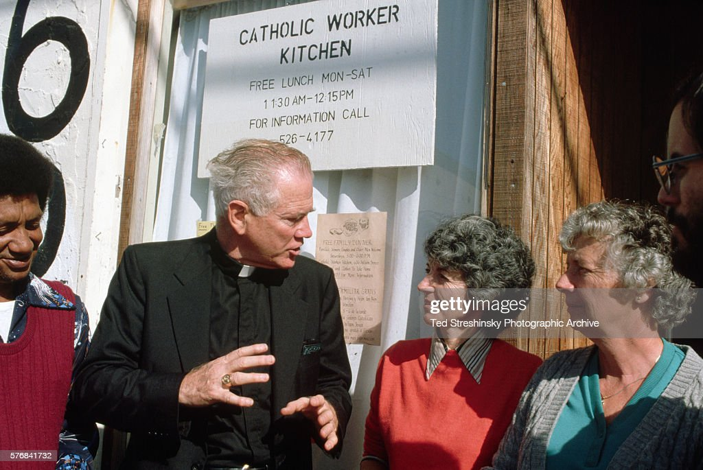 attractive San Francisco Soup Kitchen Volunteer #6: A priest thanks two women who volunteer at a San Francisco mission kitchen. 1988.