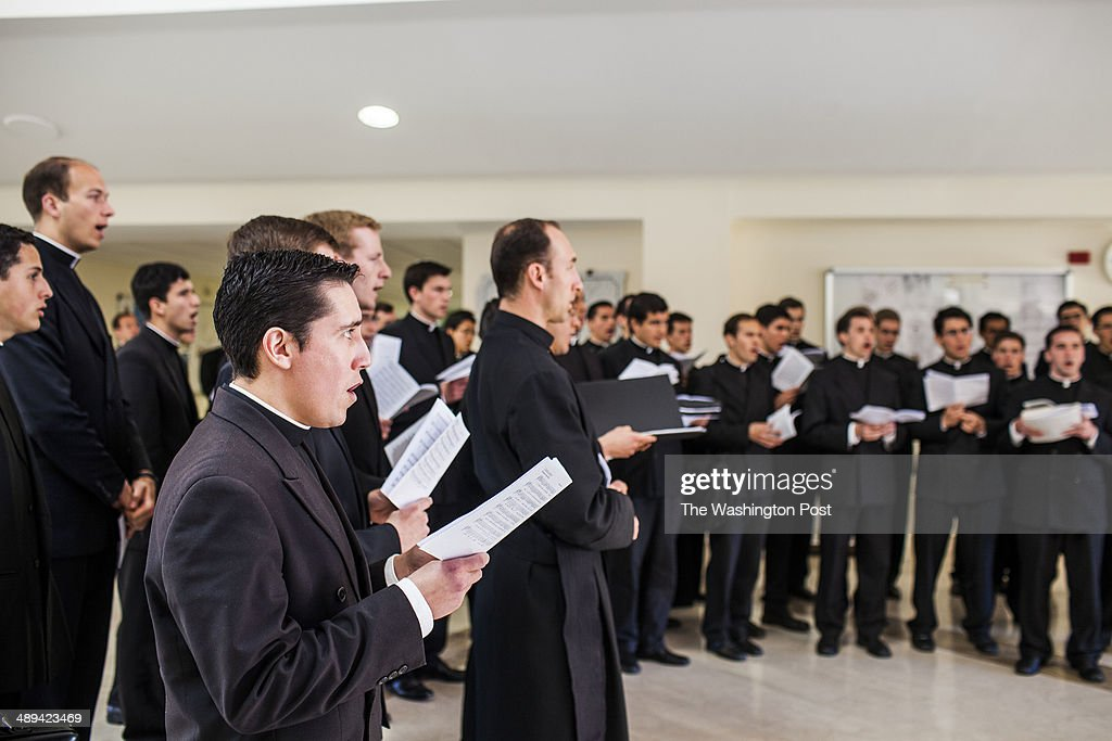Priest that are students of the Pontifical Athenaeum Regina Apostolorum are seen chanting during classes break while the Exorcism and Prayer of...