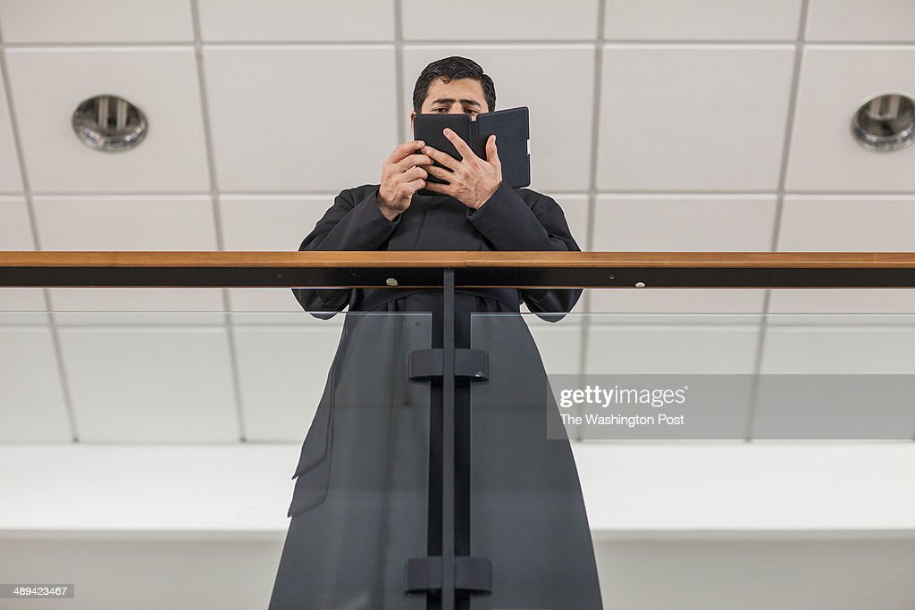 A priest that is a student of the Pontifical Athenaeum Regina Apostolorum read the Bible during classes break while the Exorcism and Prayer of...
