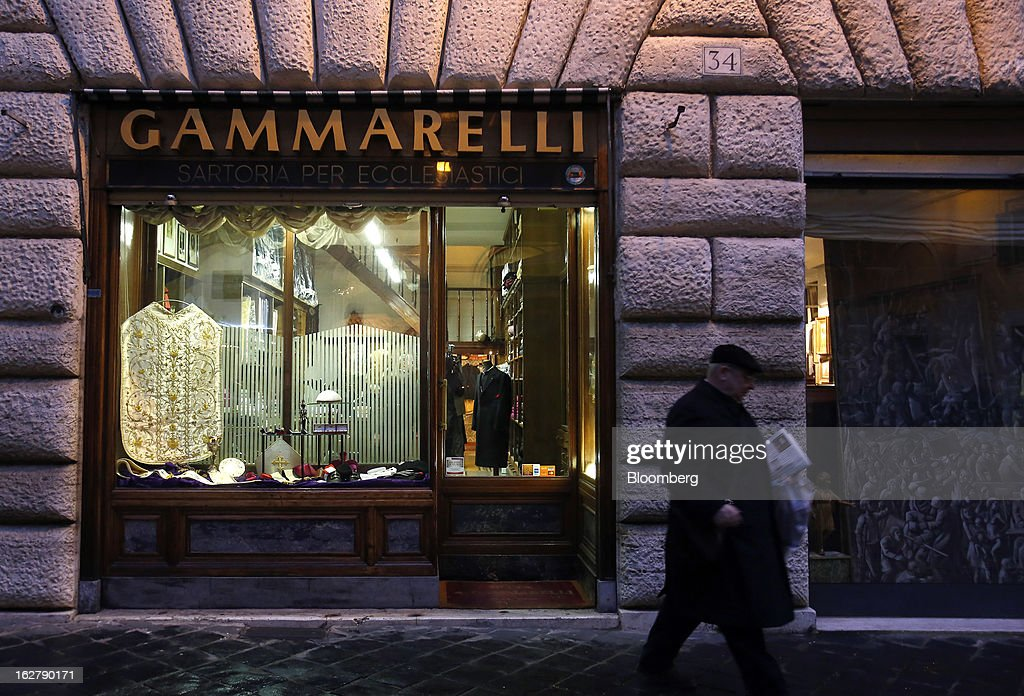 A priest walks past Gammarelli, an ecclesiastical tailors store in Rome, Italy, on Friday, Feb. 22, 2013. Gammarelli was founded in 1797 under Pope Pius VI as tailors to the clergy, and lists other papal customers as John Paul I, Paul VI, and John XXIII. Photographer: Alessia Pierdomenico/Bloomberg via Getty Images