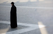 A priest walks through St Peter's Square on February 26 2013 in Vatican City Vatican The Pontiff will hold his last weekly public audience on...