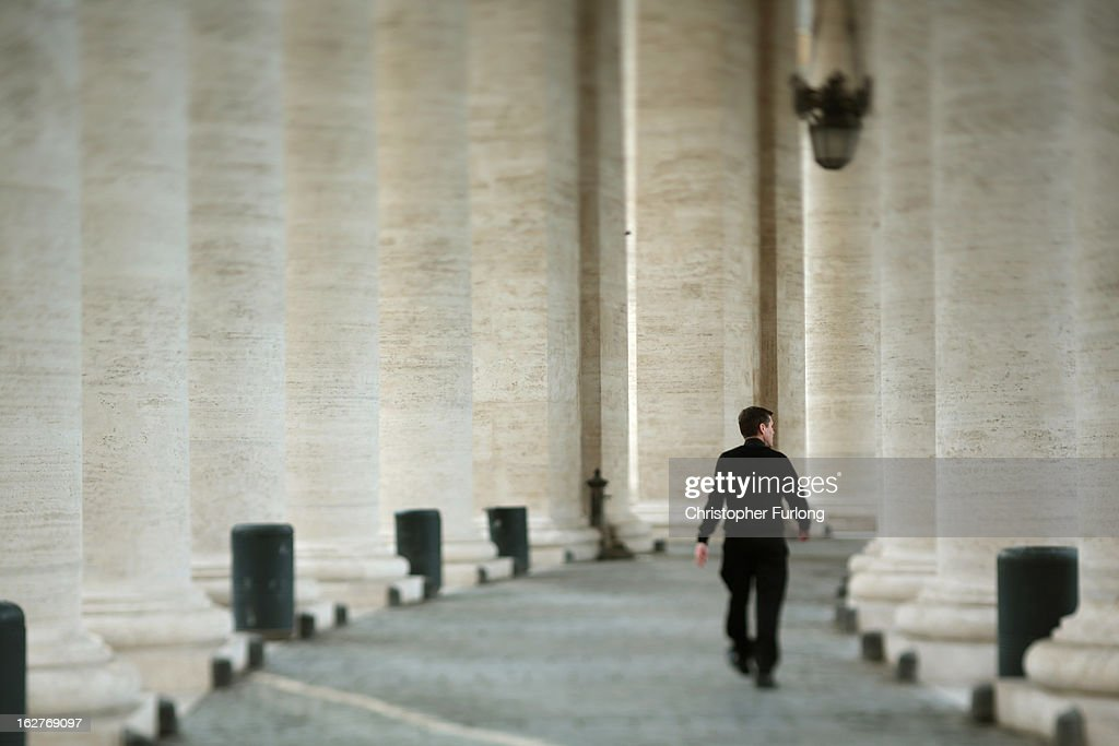 A priest walks through The Colonnade of St Peter's Square on February 26, 2013 in Vatican City, Vatican. The Pontiff will hold his last weekly public audience on February 27, 2013 before he retires the following day. Pope Benedict XVI has been the leader of the Catholic Church for eight years and is the first Pope to retire since 1415. He cites ailing health as his reason for retirement and will spend the rest of his life in solitude away from public engagements.