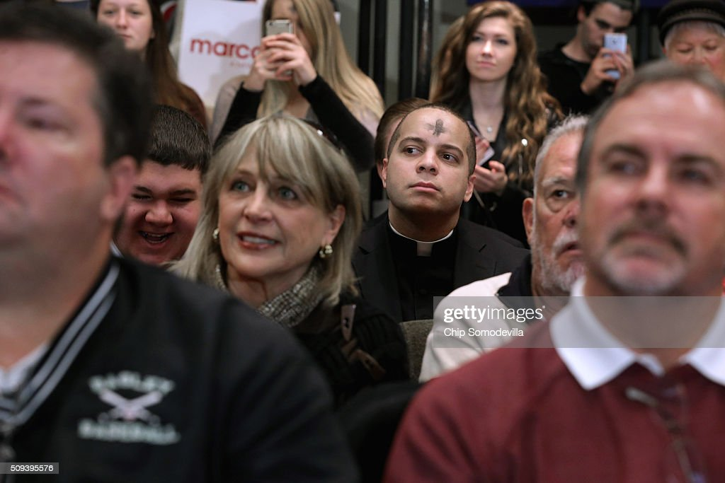 A priest with a cross on his forehead listens to Republican presidential candidate Sen. Marco Rubio (R-FL) during a campaign rally at the Columbia Metropolitan Convention Center February 10, 2016 in Columbia, South Carolina. Rubio placed fifth in the New Hampshire primary, behind fellow GOP candidates Jeb Bush, John Kasich, Sen. Ted Cruz (R-TX) and Donald Trump, who won with 35 percent of the vote.