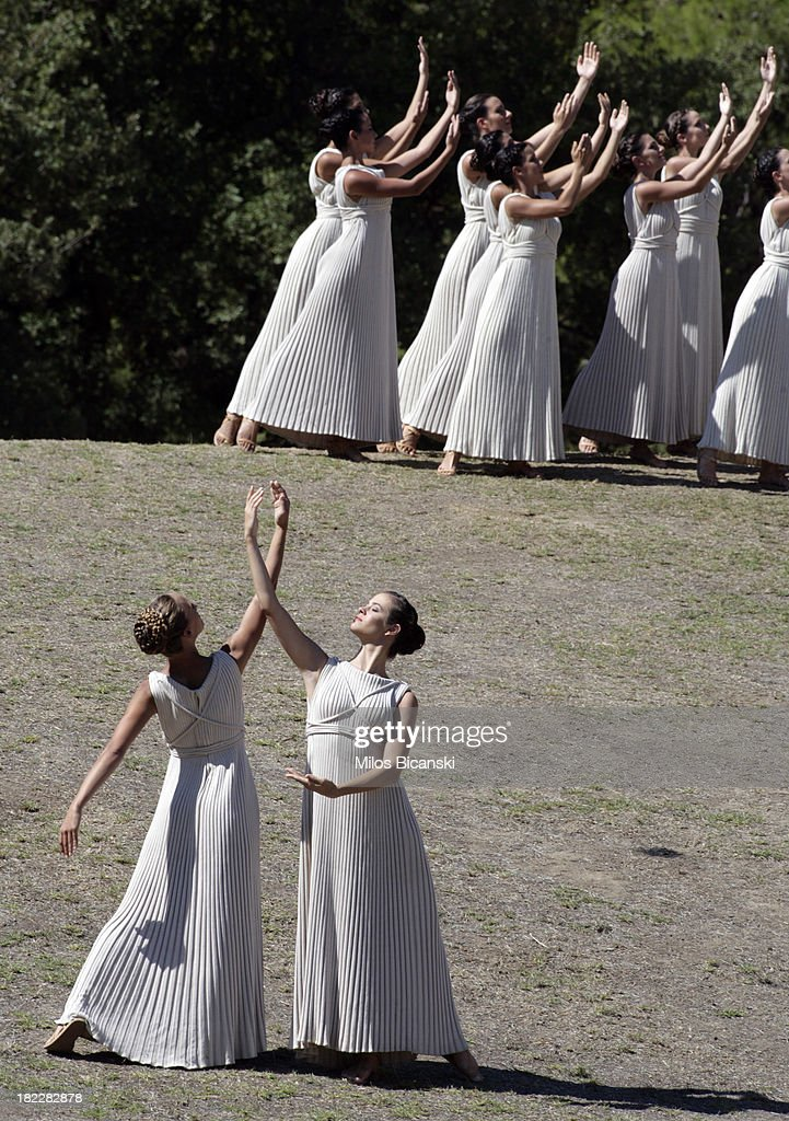 Priestesses perform during the lighting ceremony of the Olympic Flame for the Sochi 2014 Winter Olympic Games at Ancient Olympia on September 29, 2013 in Olympia, Greece.