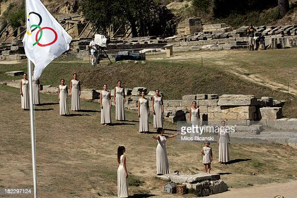 Priestesses perform during the lighting ceremony of the Olympic Flame for the Sochi 2014 Winter Olympic Games at Ancient Olympia on September 29 2013...