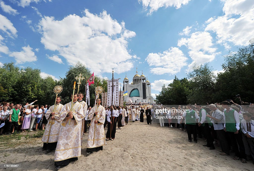 Priests and believers of The Ukrainian Greek-Catholic Church take part in a religious procession in Kiev on August 18, 2013 during the Rite of the Blessing of the Patriarchal Cathedral of the Ukrainian Greek-Catholic Church.