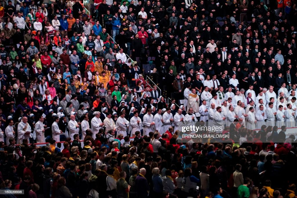 Priests and others attend mass during a youth rally at the Verizon Center January 25, 2013 in Washington, DC. The Archdiocese of Washington hosted the rally and mass prior to the annual March for Life which protests the 1973 Roe vs Wade US Supreme Court decision which legalized abortion. AFP PHOTO/Brendan SMIALOWSKI