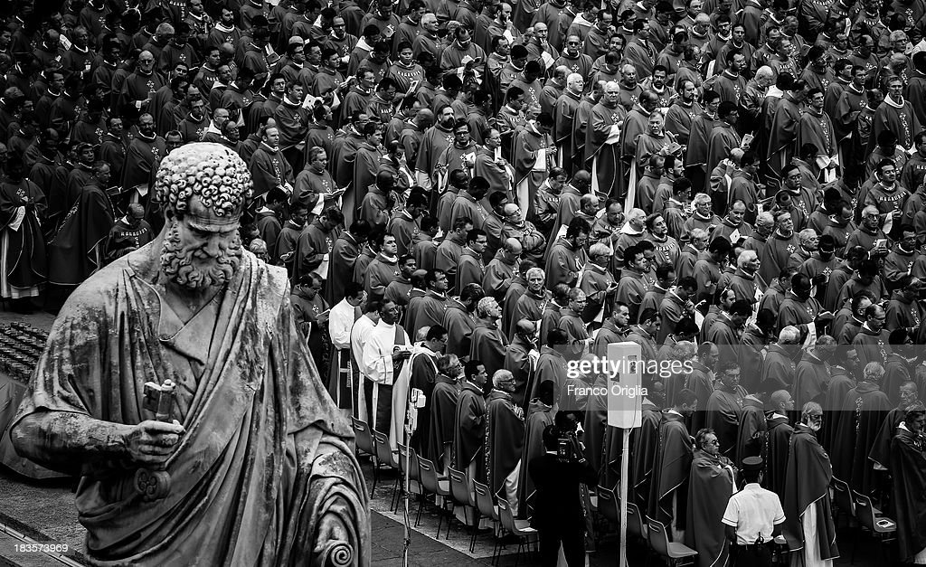 Priests attend a mass on the occasion of the Day for Catechists in St. Peter's square on September 29, 2013 in Vatican City, Vatican. After the success of his Social networking accounts of Twitter and Facebook, Pope Francis joined Instagram, reporting today more than 8000 followers.